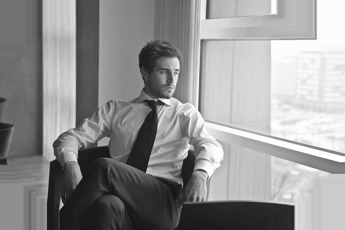Gentleman looking out window